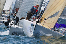 J/80 sailing crew at mark