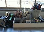 Organized pens, pencils, scissors and blades.