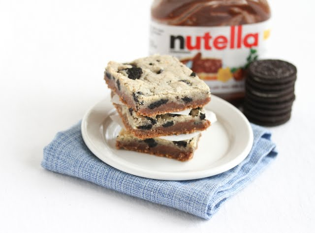 photo of a stack of cookies with oreos and a jar of nutella in the background