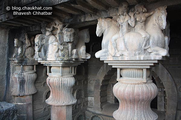 Sculptures made at the head ends of the pillars of Bedse Caves
