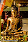 Buddha statue ate Wat Klong Prao covered of gold