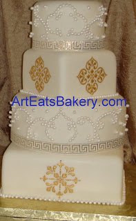 Four tier round and square custom wedding cake with gold stencil and sugar pearl designs