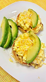 After toasting some English Muffins, I scrambled some eggs and instead of a rich Hollandaise sauce sauce, I just sliced up some avocados and added a sprinkle of some shredded triple cheddar cheese and it was luxurious without all the fat.
