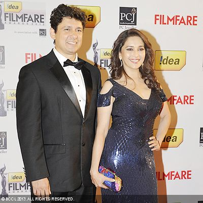 The gorgeous couple Madhuri Dixit and Shriram Nene set the red carpet on fire during the 58th Idea Filmfare Awards 2013, held at Yash Raj Films Studios in Mumbai.Click here for:<br />  58th Idea Filmfare Awards