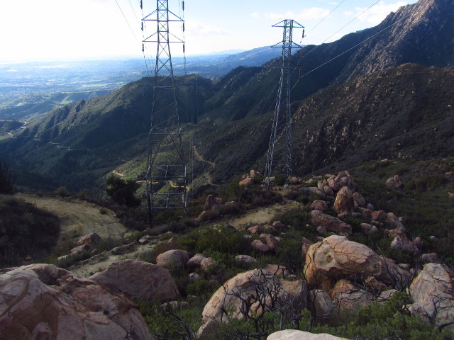the towers at the top of Mission Canyon with Tunnel Trail twisting along below