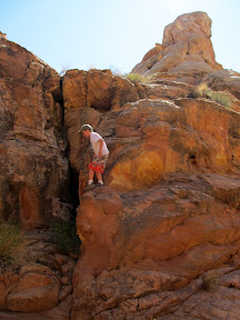 Bradley climbing back into the canyon below the dryfall