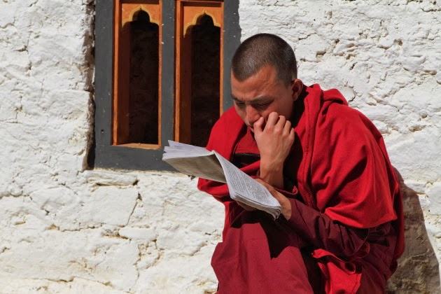 Buddhist Monk studies at Simtokha Dzong, Bhutan