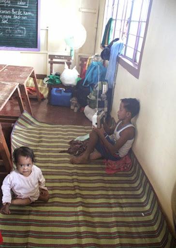 Yolanda survivors in Tacloban waiting for news about Typhoon Glenda