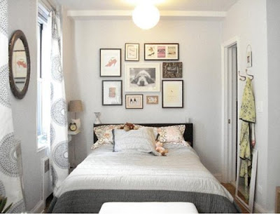 Marvelous This bedroom leaves room for little else than the bed but a wonderful cluster of framed art above the headboard makes it full of life