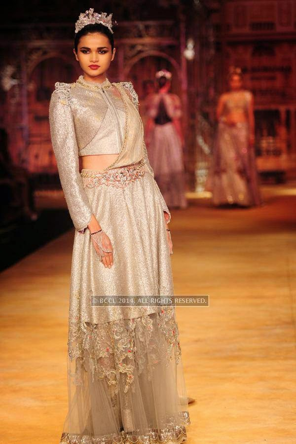 A model walks the ramp for Sulakshana on Day 6 of India Couture Week, 2014, held at Taj Palace hotel, New Delhi.<br />