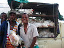 Some chicken sellers on pension day, proudly displaying how tasty their chickens' feet are!