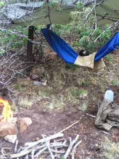 Tarp being used as a Survival Bed/Hammock