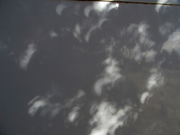Eclipse shadows on the camp trailer