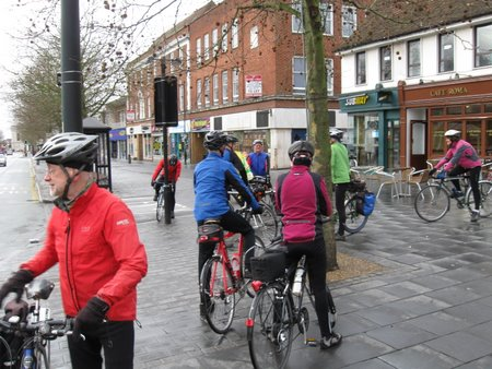Lots of cyclists outside cafe