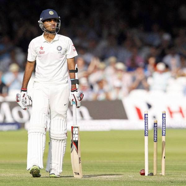 India's Bhuvneshwar Kumar walks back to the pavilion after being bowled by England's Stuart Broad for 36 runs during play on the first day of the second cricket Test match between England and India at Lord's cricket ground in London on July 17, 2014.