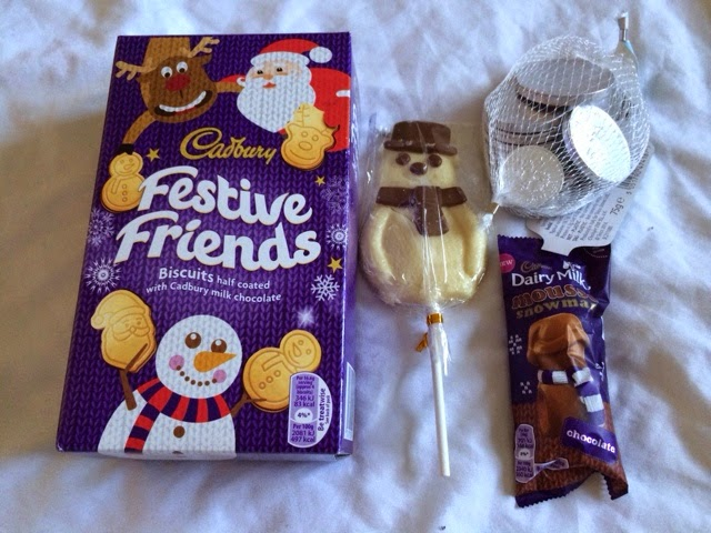 Christmas biscuits, snowman lolly, chocolate coins