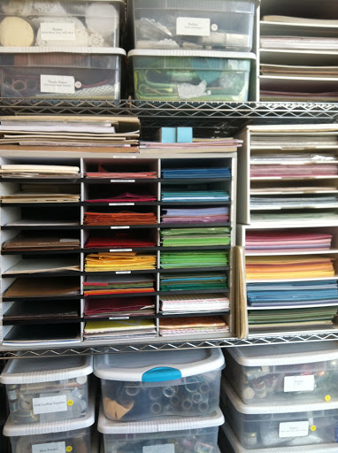 Blake reorganized the paper drawers by color.