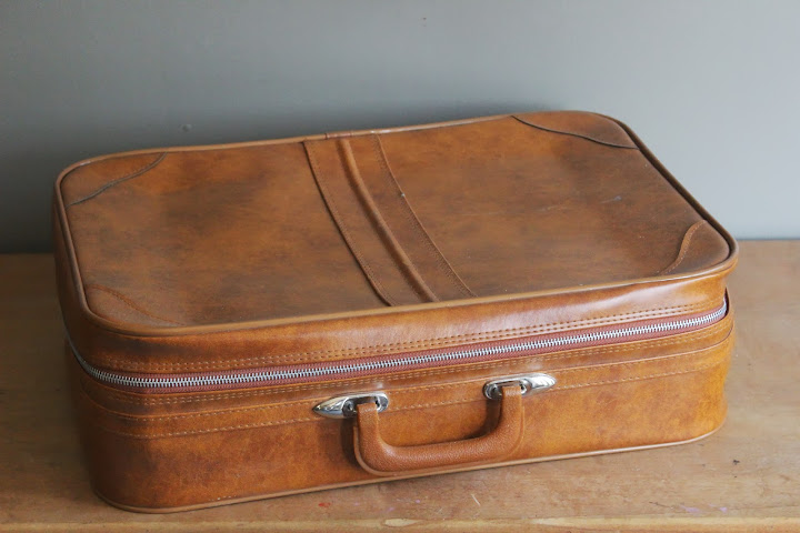 Large tan suitcase available for rent from www.momentarilyyours.com, $5.