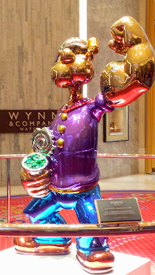 Popeye art piece by Jeff Koons, made with high chromium stainless steel with transparant color coating inside the Wynn Esplanade