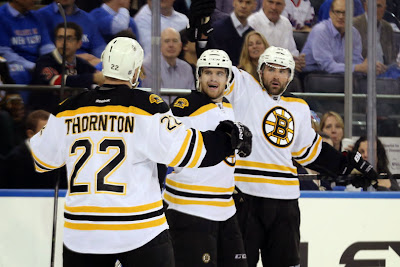 The Bruins 4th line celebrates the eventual game winning goal
