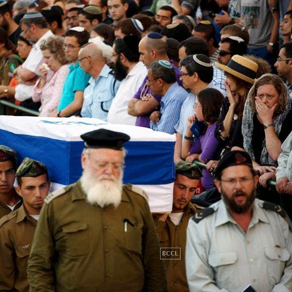 Israeli soldiers carry the coffin of Sgt. Barkay Shor, who was killed in the fighting in Gaza during his funeral at the Mount Herzel military cemetery in Jerusalem.