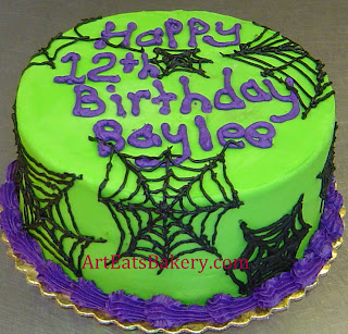 Green, purple and black spider webs butter cream 12th birthday cake