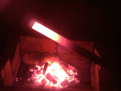 See, with the blower, the fire gets hotter. Look at that metal glow!