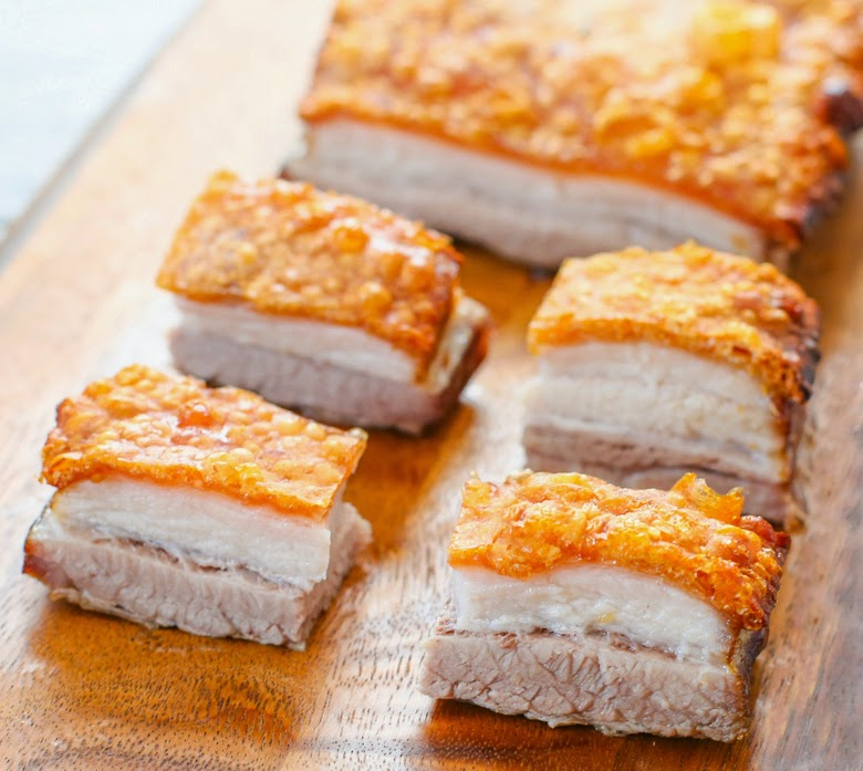 close-up photo of four slices of pork belly