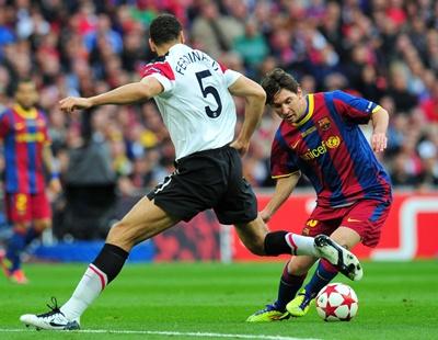 Messi with Rio Ferdinan, Barcelona - Manchester United