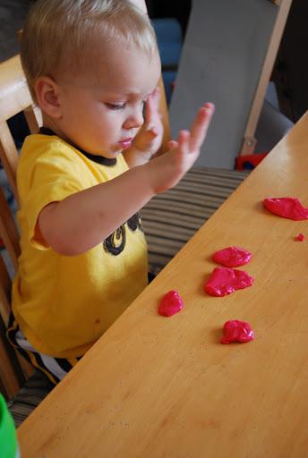 Elijah plays with goo