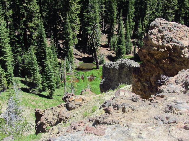 shallow ponds below big rocks nearby