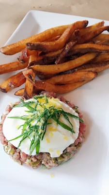 Little Bird Bistro's steak tartare with gribiche, poached egg, fries and that they ground fresh to order at lunch