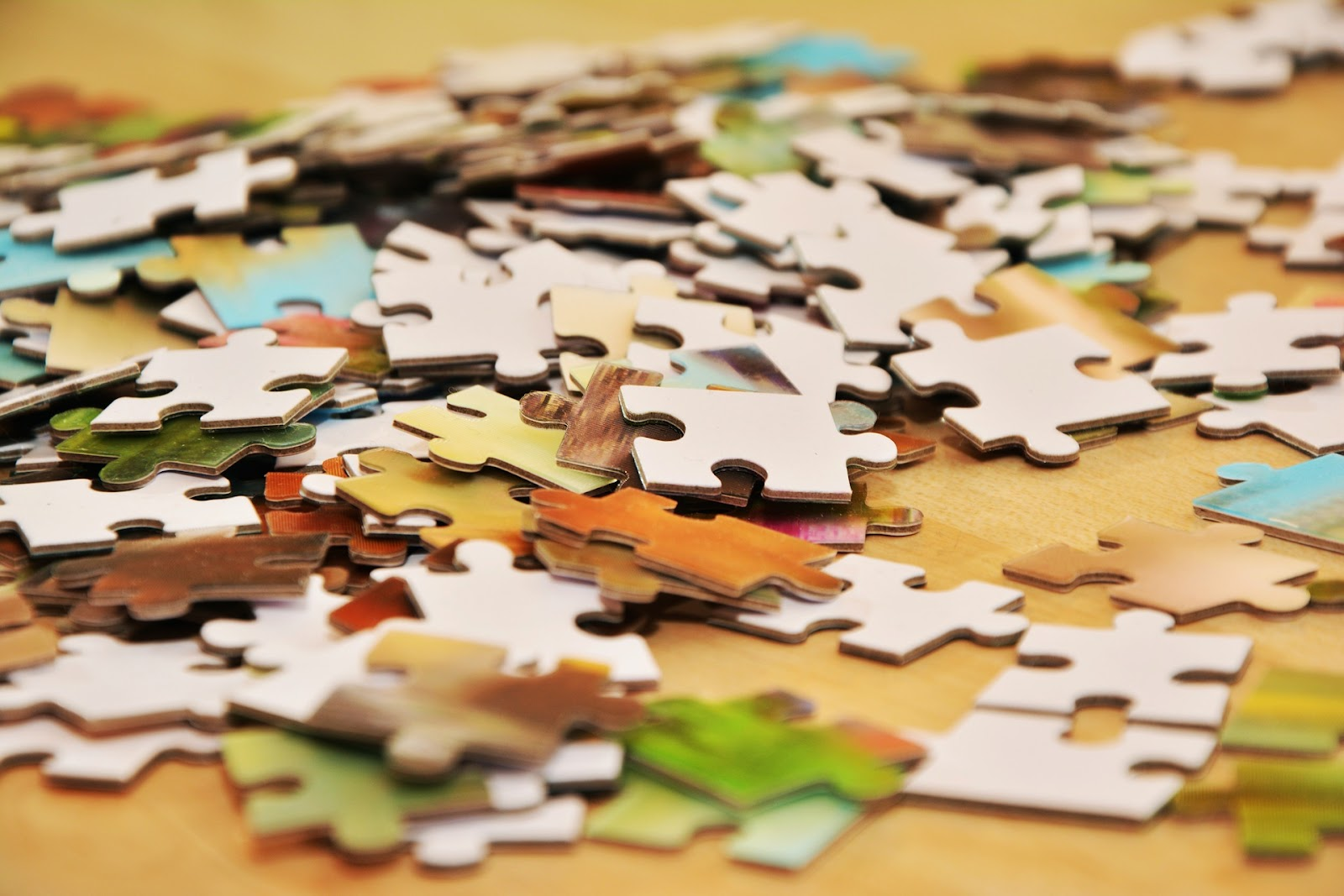 a pile of scattered puzzle pieces