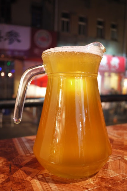 pitcher of unpasteurized Tsingtao beer