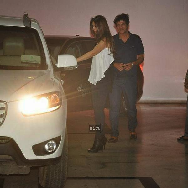 Chunkey and Bhavna Pandey leave after attending Karan Johar's party, organised at his residence, on July 26, 2014.(Pic: Viral Bhayani)