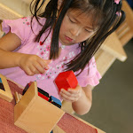 Montessori preschool girl in Irvine working with Binomial Cube