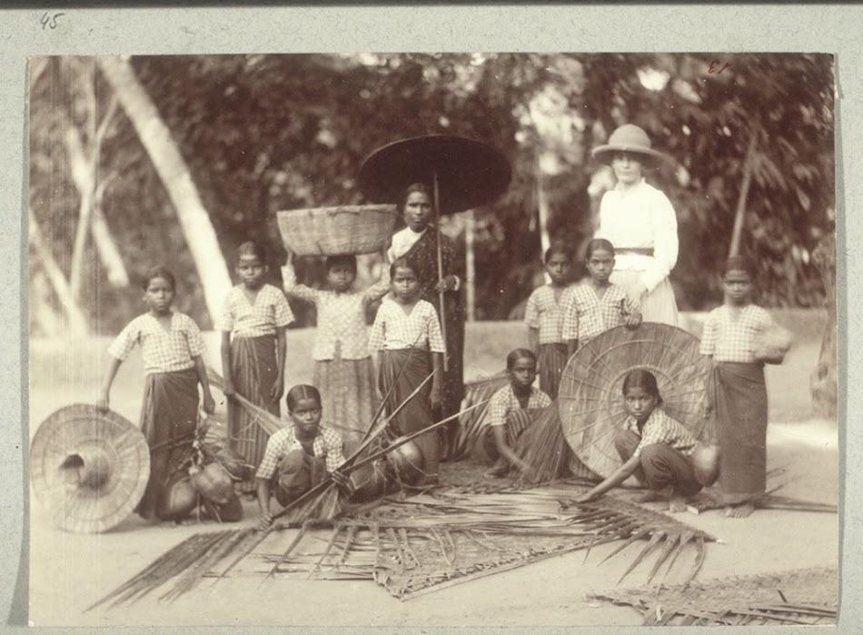 Work in the coconut garden, weaving mats  - BM Archives