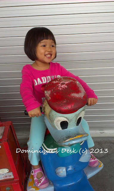 Tiger girl on a kiddy ride.