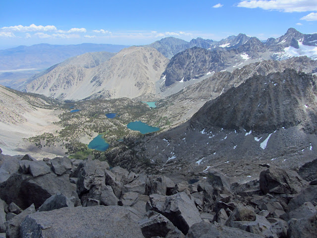 wide basin below with many different colored lakes