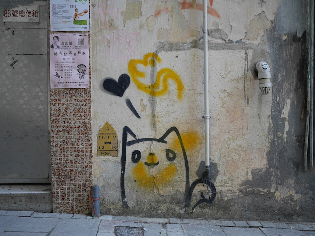 graffiti on a wall of a cat and a heart