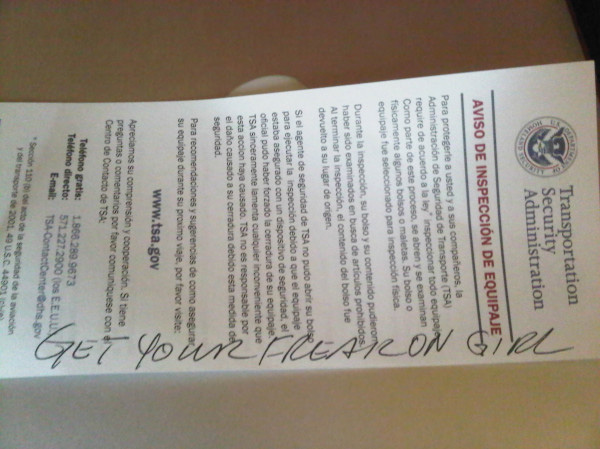 "TSA inspection slip with the words ""Get your freak on girl"" written across it"