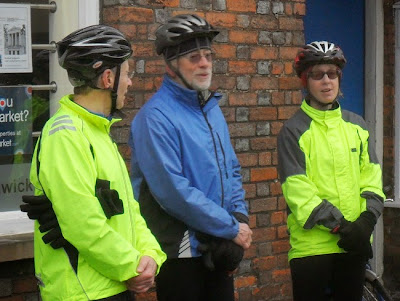 three cyclists