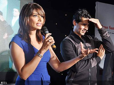 Bipasha and Dino address the media and fans during the launch of Dino's fitness brand in Mumbai. (Pic: Viral Bhayani)