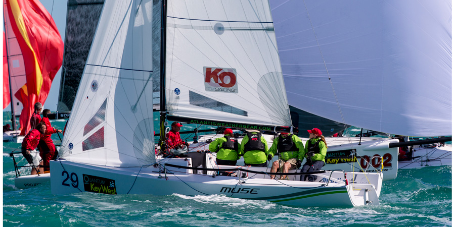 J/70 one-design speedsters- sailing past mark