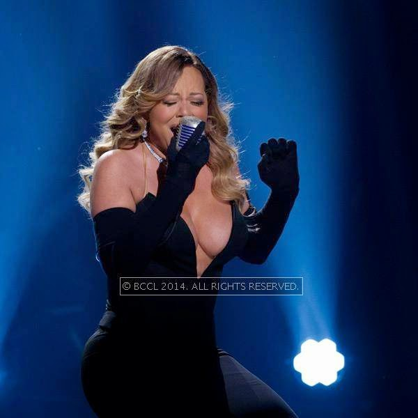 Singer-songwriter Mariah Carey exposed more than desired while performing onstage at BET Honors 2014, at the Warner Theatre in Washington.