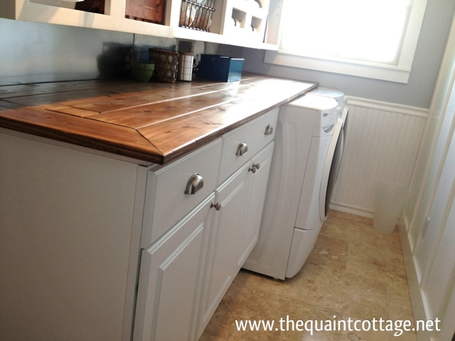 the quaint cottage: cabinet installation in laundry room Installing Cabinets in Laundry Room