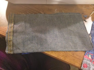 Jean fabric cut to make the tool belt.