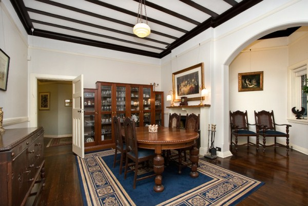 Coffered ceiling with wall arch and original style furnishings
