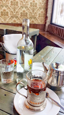 Tea at Kachka. I like how the water bottles evoke a look like you are drinking vodka