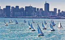 J/105s one-design fleet sailnig up San Francisco City Front